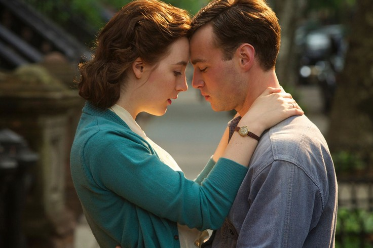 Saoirse Ronan as Eilis Lacey and Emory Cohen as Tony