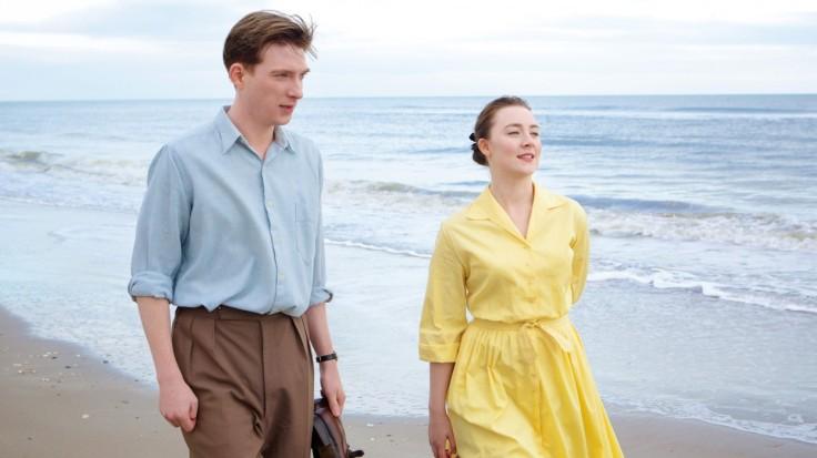 Domhnall Gleeson as Jim Farrell and Saoirse Ronan as Eilis Lacey