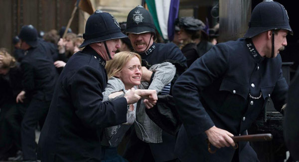 Anne-Marie Duff as Violet Miller being arrested by police